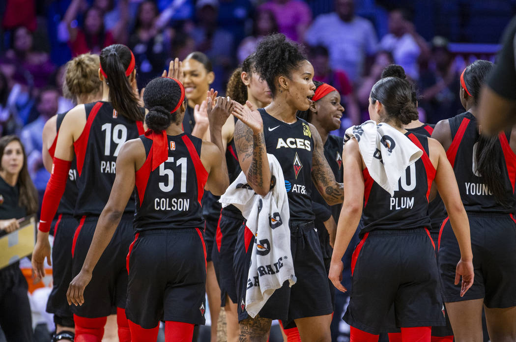 Las Vegas Aces forward Tamera Young (1) and teammates celebrate their win over the Los Angeles ...