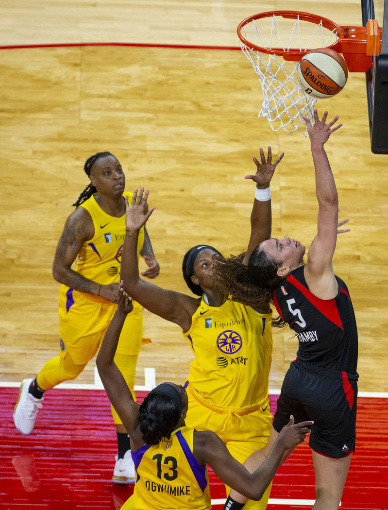 Las Vegas Aces forward Dearica Hamby (5) lays in the ball over Los Angeles Sparks center Kalani ...