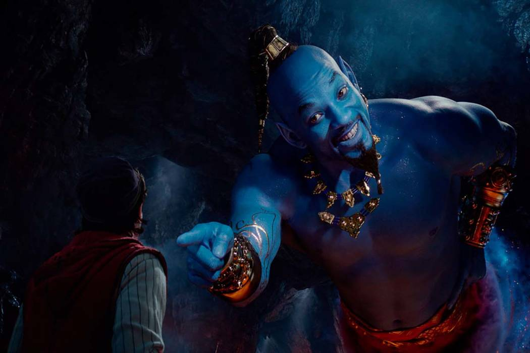 This image released by Disney shows Mena Massoud as Aladdin, left, and Will Smith as Genie in D ...