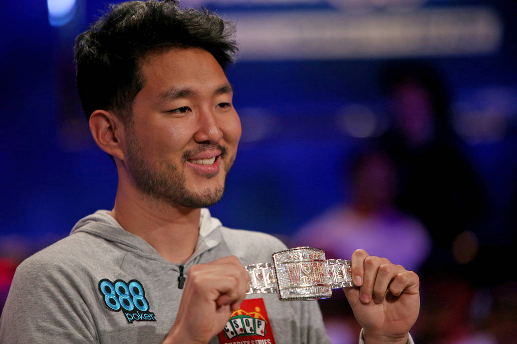 John Cynn holds his gold championship bracelet after winning the World Series of Poker tourname ...