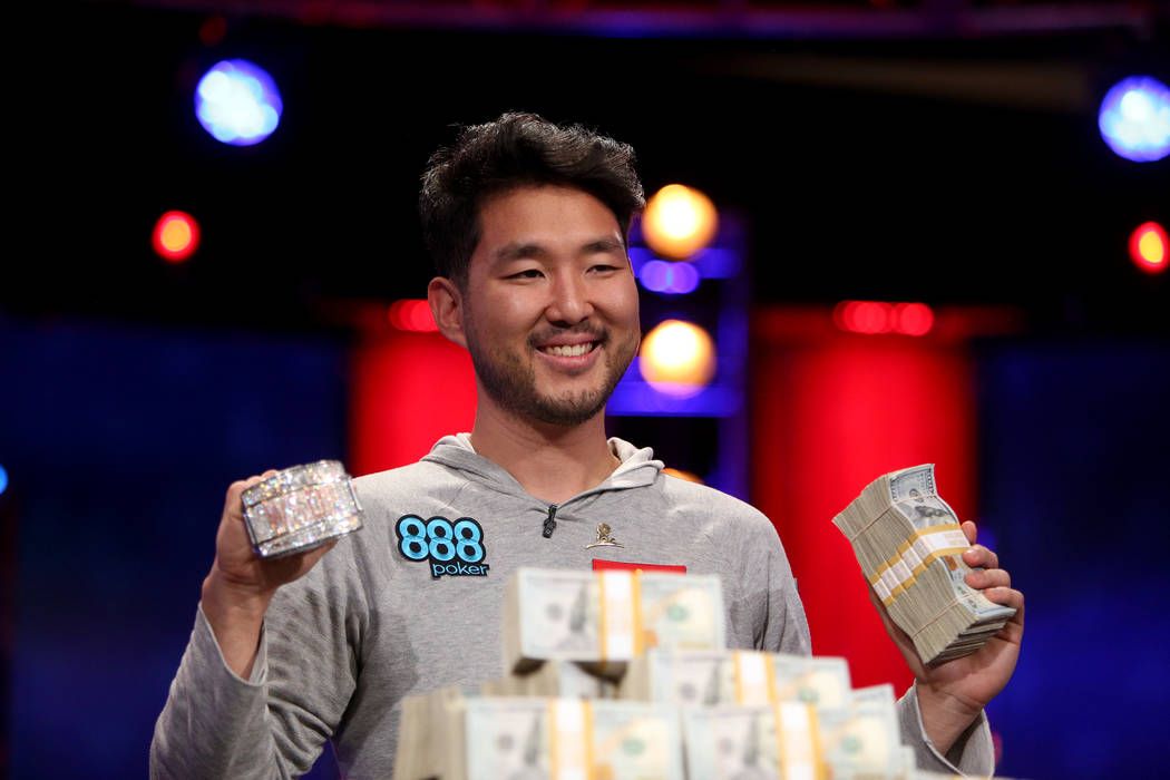 John Cynn holds his gold championship bracelet and cash after winning the World Series of Poker ...