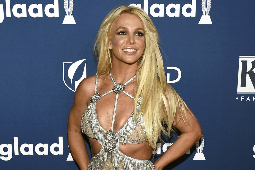 FILE - In this April 12, 2018 file photo, Britney Spears arrives at the 29th annual GLAAD Media ...
