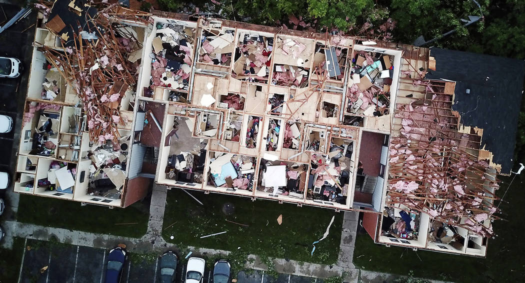 This aerial photo shows tornado damage at the Westbrooke Village Apartment complex in Trotwood, ...