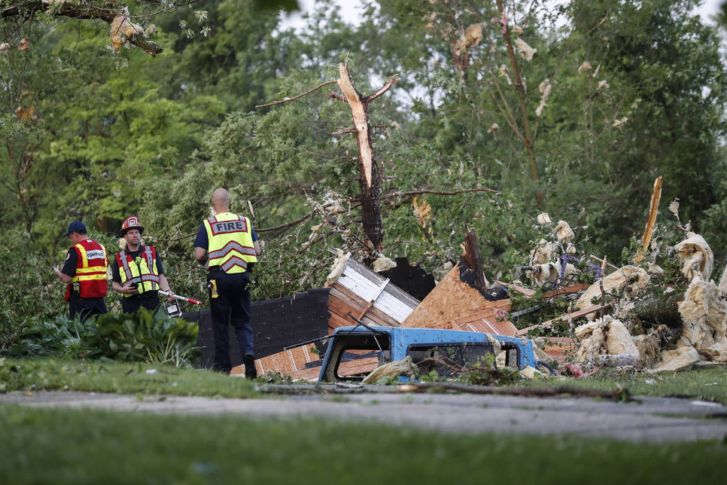Storm damage liters a residential neighborhood, Tuesday, May 28, 2019, in Vandalia, Ohio. A rap ...