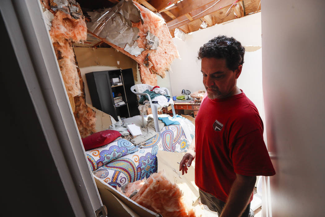 Shaun Vaine walks through his destroyed home at the River's Edge apartment complex, Tuesday, Ma ...