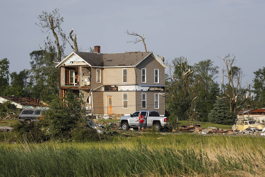 Homes stand damaged after a tornado passed through the area the previous evening, Tuesday, May ...