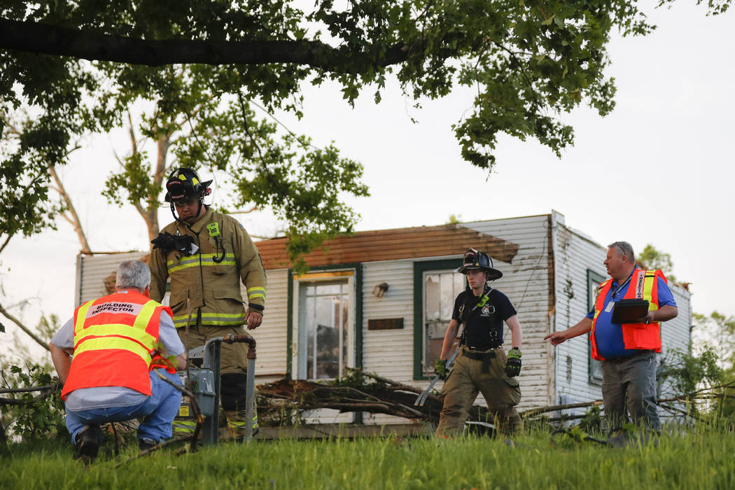 Storm damage litters a residential neighborhood, Tuesday, May 28, 2019, in Vandalia, Ohio. A ra ...