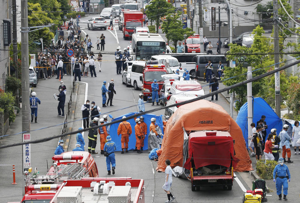 Rescuers work at the scene of an attack in Kawasaki, near Tokyo Tuesday, May 28, 2019. A man wi ...