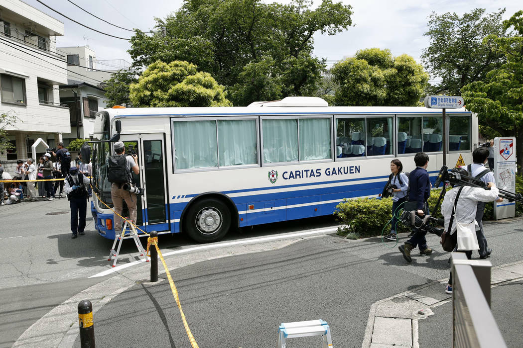 CARITAS Elementary School bus is seen near the scene where a man wielding a knife attacked comm ...