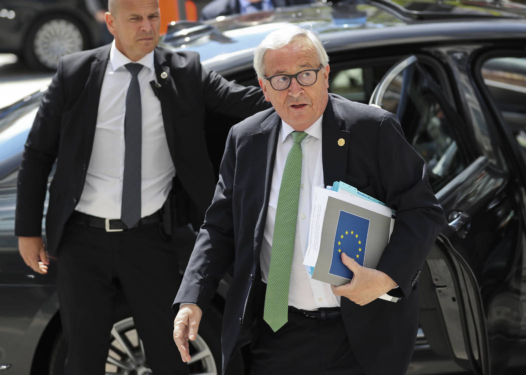European Commission President Jean-Claude Juncker, right, arrives for a meeting of the European ...