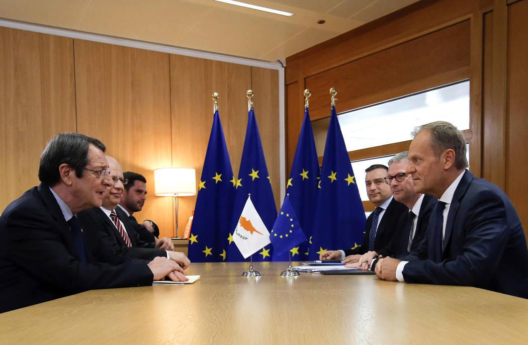 Cypriot President Nicos Anastasiades, left, meets with European Council President Donald Tusk o ...