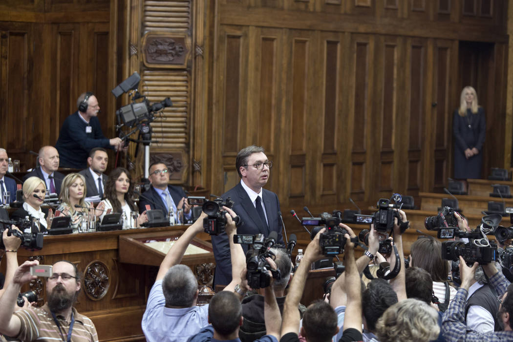 Aleksandar Vucic, the president of Serbia, center, prepares to speak during a session of Serbia ...