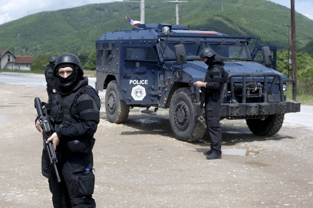 Kosovo police special unit members secure the area near the village of Cabra, north western Kos ...