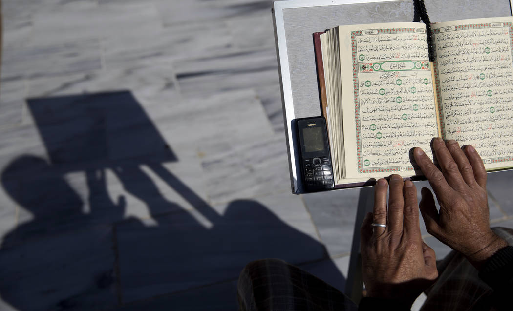 FILE - In this May 8, 2019 file photo, a Palestinian reads verses of the Quran, Islam's holy bo ...