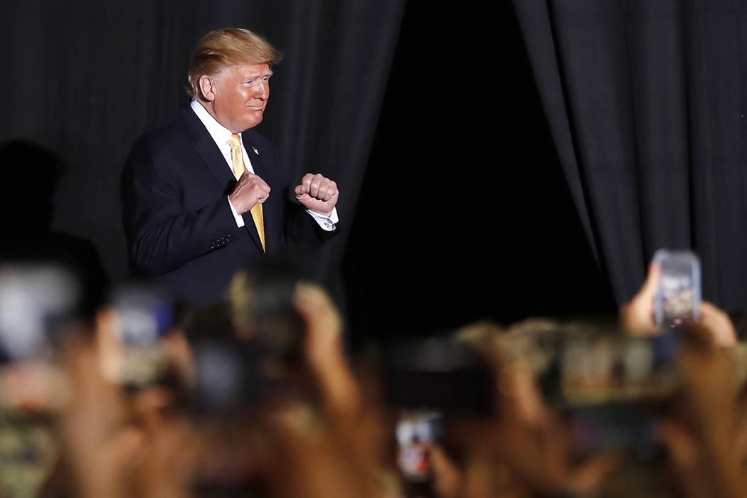 U.S. President Donald Trump greets U.S. servicemen at U.S. Navy multipurpose amphibious assault ...