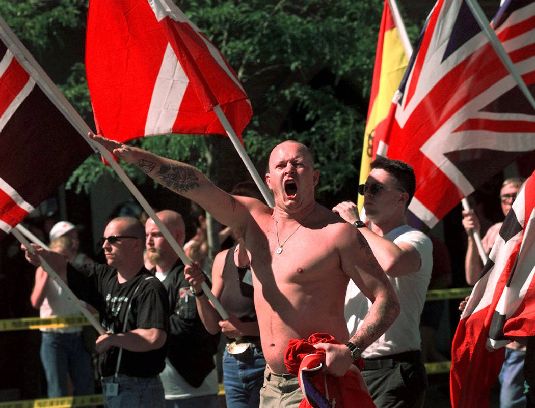 FILE - In this July 18, 1998, file photo, Karl Wolf raises his arm in a Nazi salute as he march ...