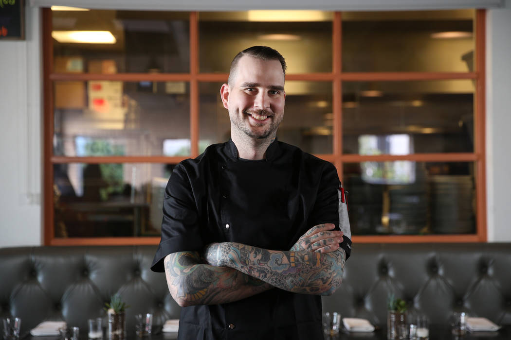 Jackson Stamper, executive chef of the Kitchen at Atomic, poses inside the restaurant in Las Ve ...