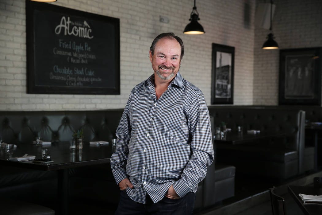 Lance Johns, owner of the Kitchen at Atomic, poses inside his restaurant in Las Vegas, Friday, ...