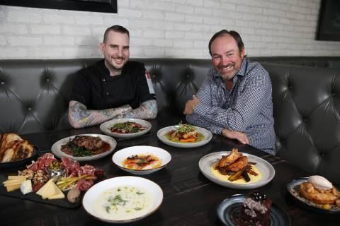 Executive chef Jackson Stamper, left, and restaurant owner Lance Johns, pose inside the Kitchen ...