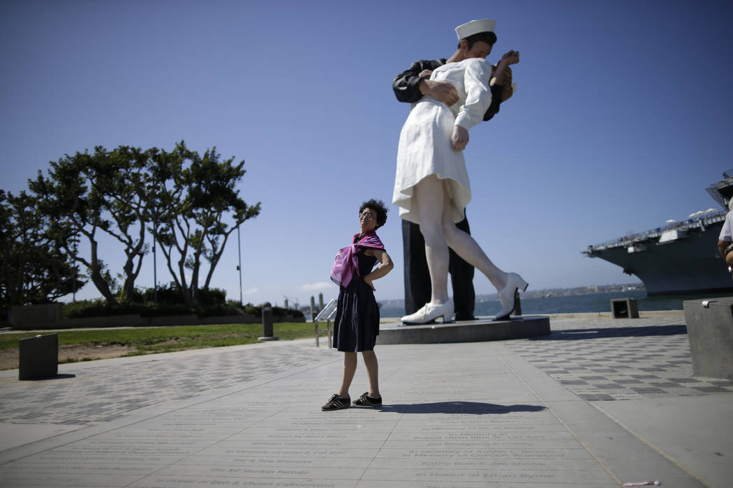 "In a Sept. 18, 2015, file photo a tourist from China stands in front of the sculpture ""Uncondit ..."
