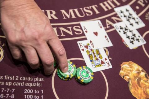 Blackjack is dealt at the MGM Grand hotel-casino on Thursday, April 19, 2018, in Las Vegas. Ben ...