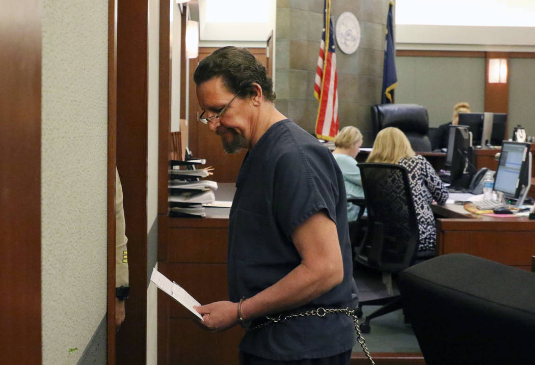 Christopher Sena, convicted of videotaping sex acts with children, is led out of the courtroom ...
