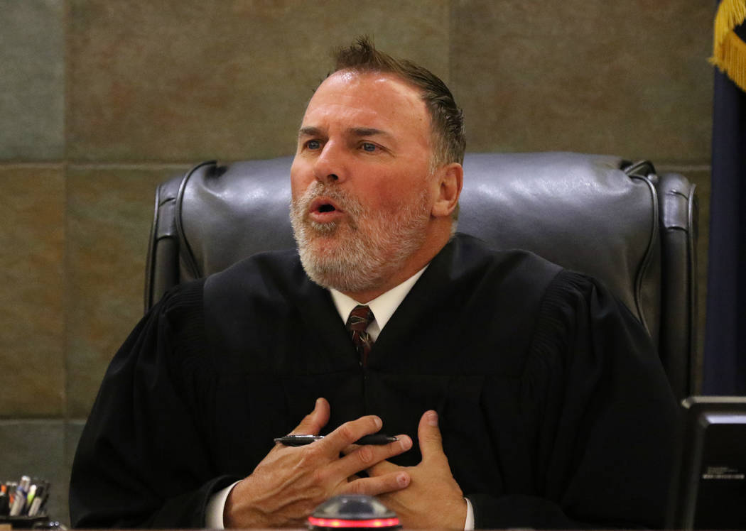 District Judge William Kephart presides during the sentencing of Christopher Sena, convicted of ...
