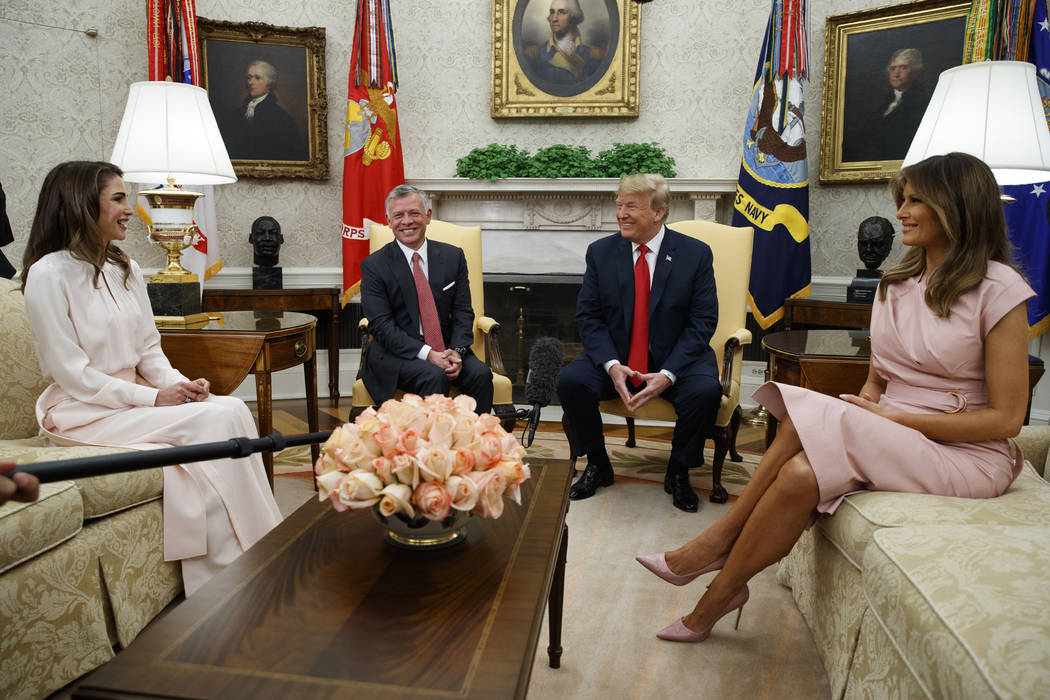 FILE - In this June 25, 2018 file photo, President Donald Trump and first lady Melania Trump m ...