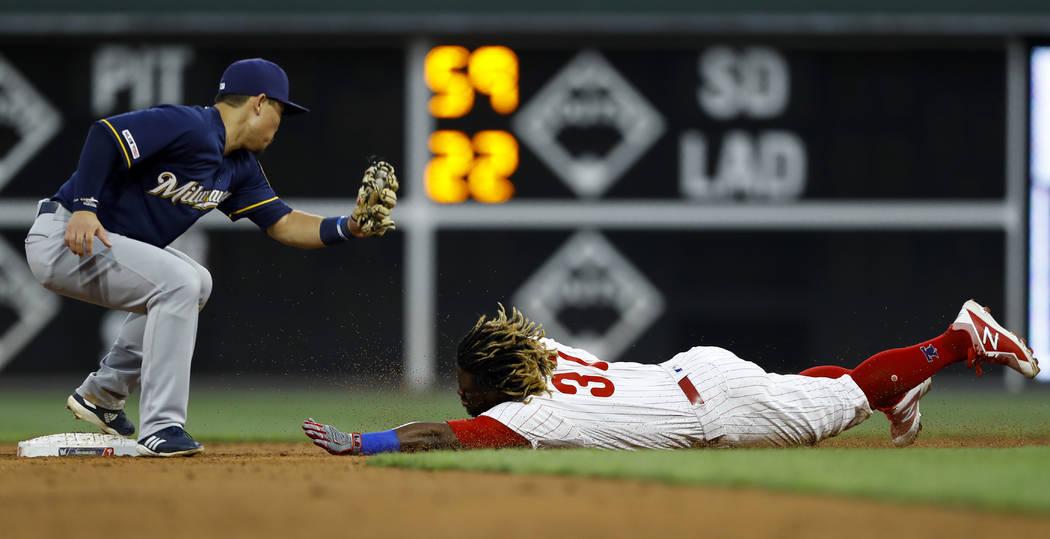 Philadelphia Phillies' Odubel Herrera, right, steals second base past Milwaukee Brewers second ...