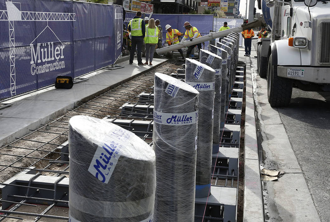 Construction crews pour cement where they began installing steel posts on the Las Vegas Strip n ...