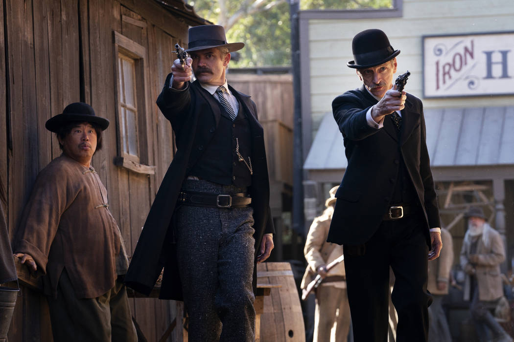 "Timothy Olyphant, left, and John Hawkes in ""Deadwood: The Movie."" (Warrick Page/HBO)"