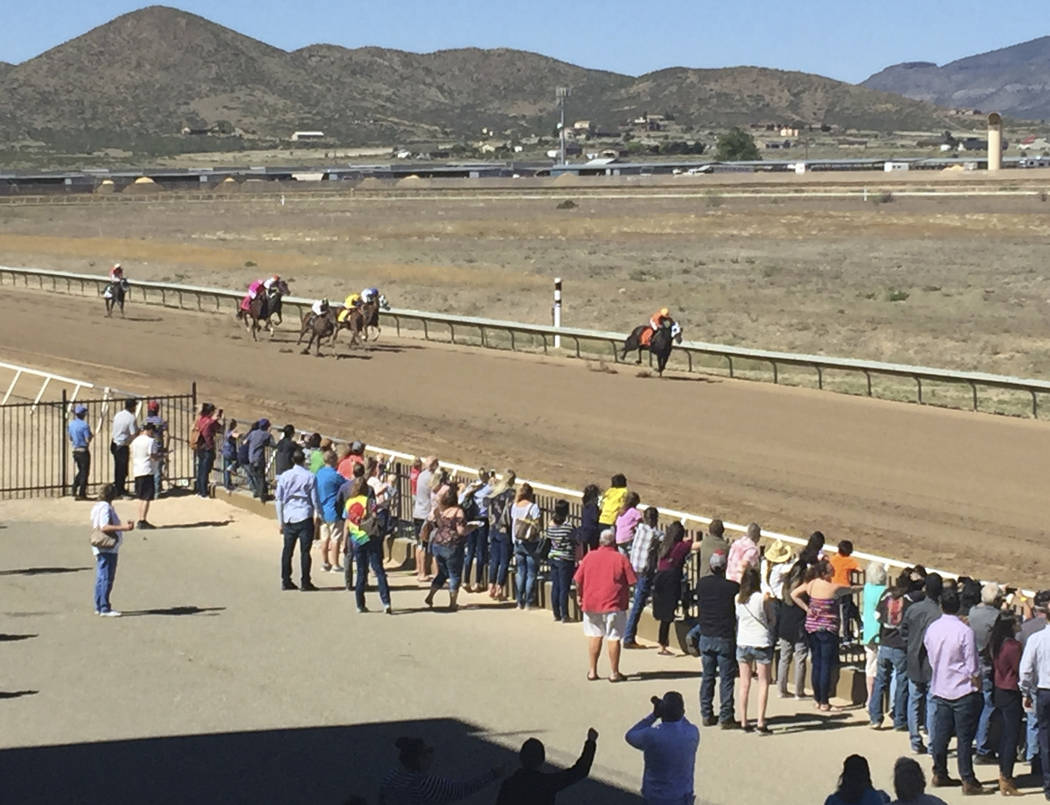 Horses race down the track at Arizona Downs in Prescott Valley, AZ, May 25, 2019. (Mike Brunker ...