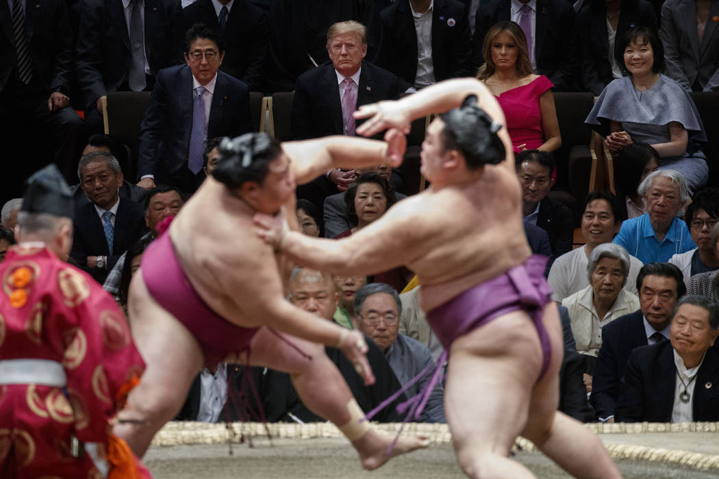 President Donald Trump attends the Tokyo Grand Sumo Tournament with Japanese Prime Minister Shi ...