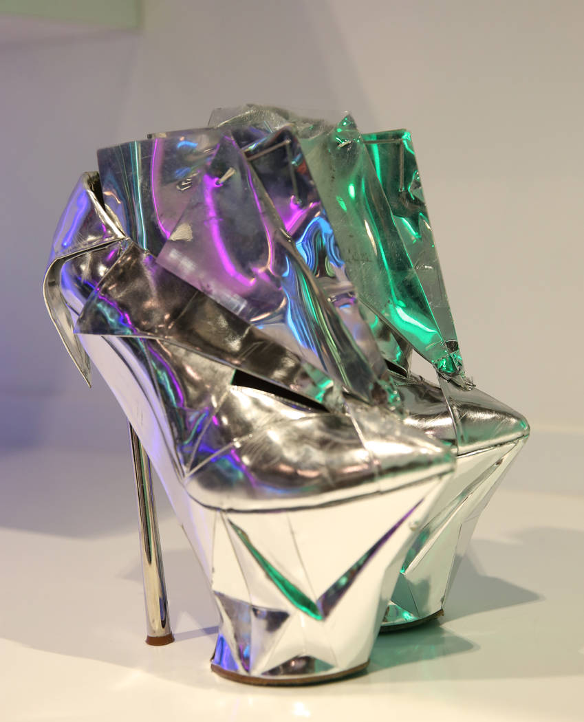 Custom boots worn by Lady Gaga is displayed at Haus of Gaga store during a media preview on Wed ...
