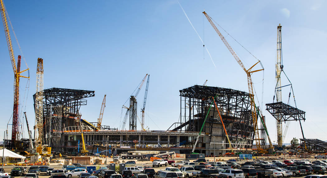 The newest truss is lifted and soon attached to the top of Raiders Stadium on Wednesday, May 1, ...