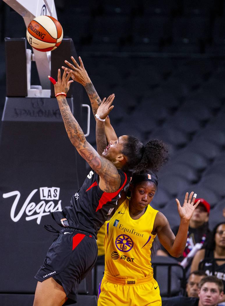 Las Vegas Aces forward Tamera Young (1) gets off a second shot over Los Angeles Sparks guard Al ...