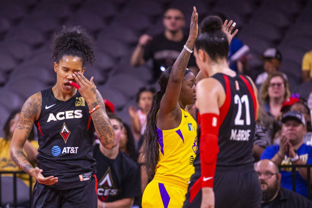 Las Vegas Aces forward Tamera Young (1) reacts to a poke in the eye from Los Angeles Sparks gua ...