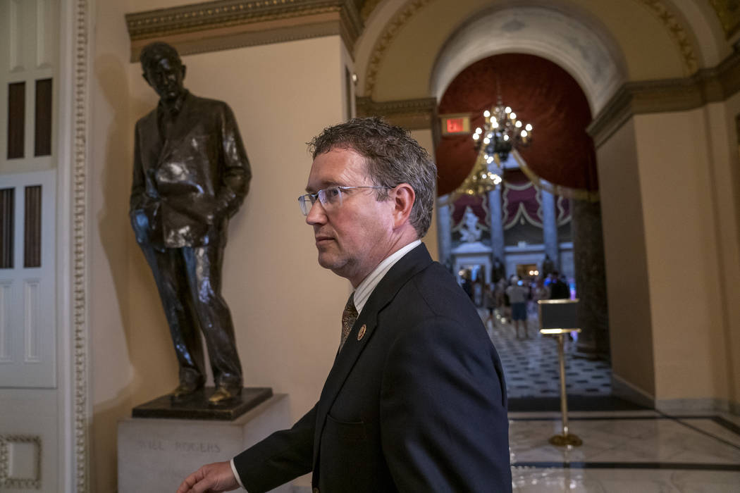 Republican, Rep. Thomas Massie, R-Ky., leaves after speaking to reporters at the Capitol where ...