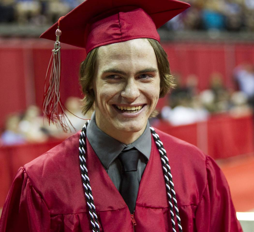 Daxton Beck, the son of slained Metro Officer Alyn Beck, during his graduation ceremony at Thom ...