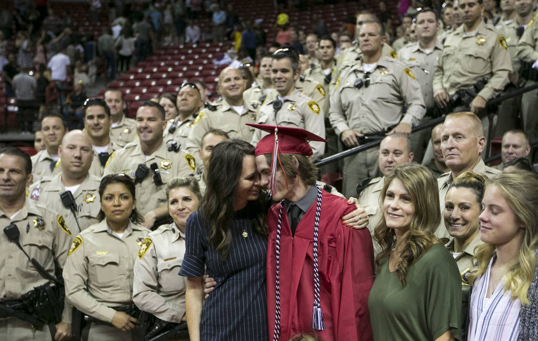 Daxton Beck gets a hug from his mother Nicole Beck as they gather for a photo with a group of M ...