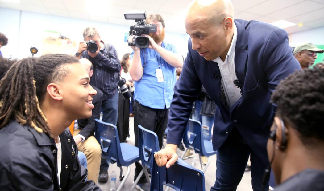 Presidential hopeful Sen. Cory Booker, D-N.J., visits with Cheyenne High School seniors Jeremia ...