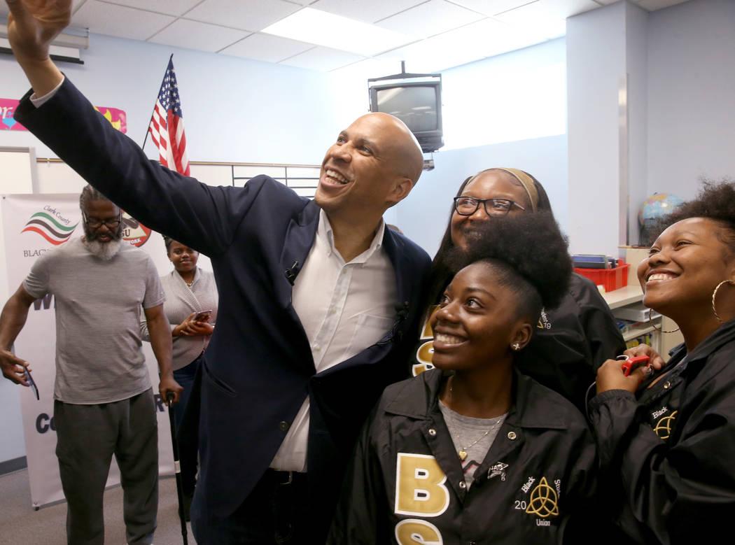Presidential hopeful Sen. Cory Booker, D-N.J., takes a selfie with Cheyenne High School seniors ...