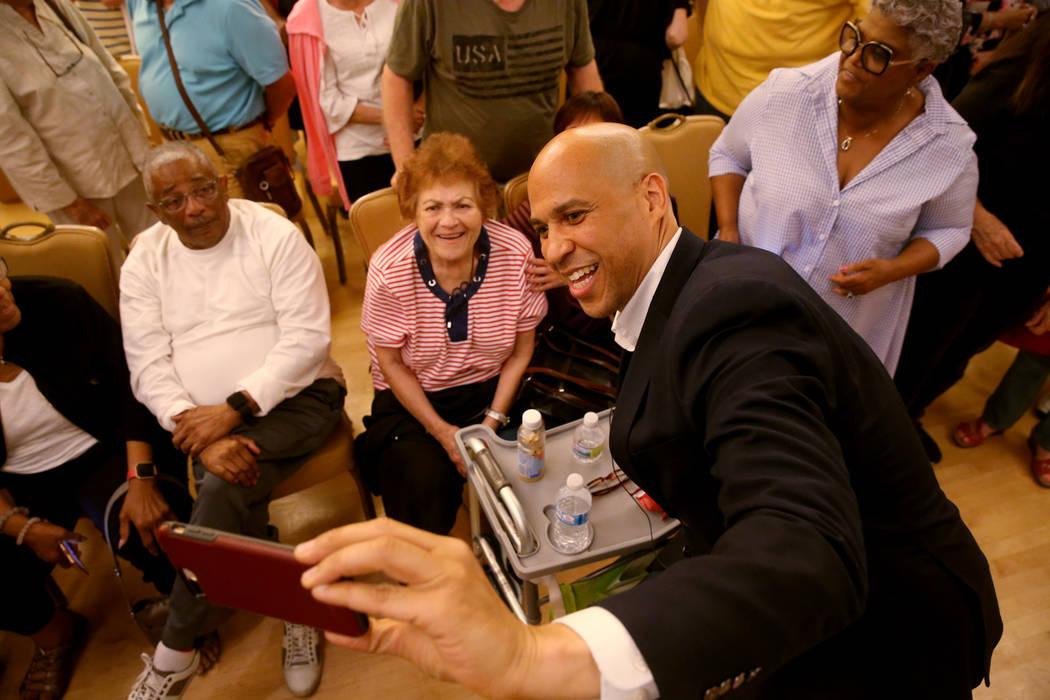 Presidential hopeful Sen. Cory Booker, D-N.J., takes a selfie with Lucille Lucas of Henderson d ...