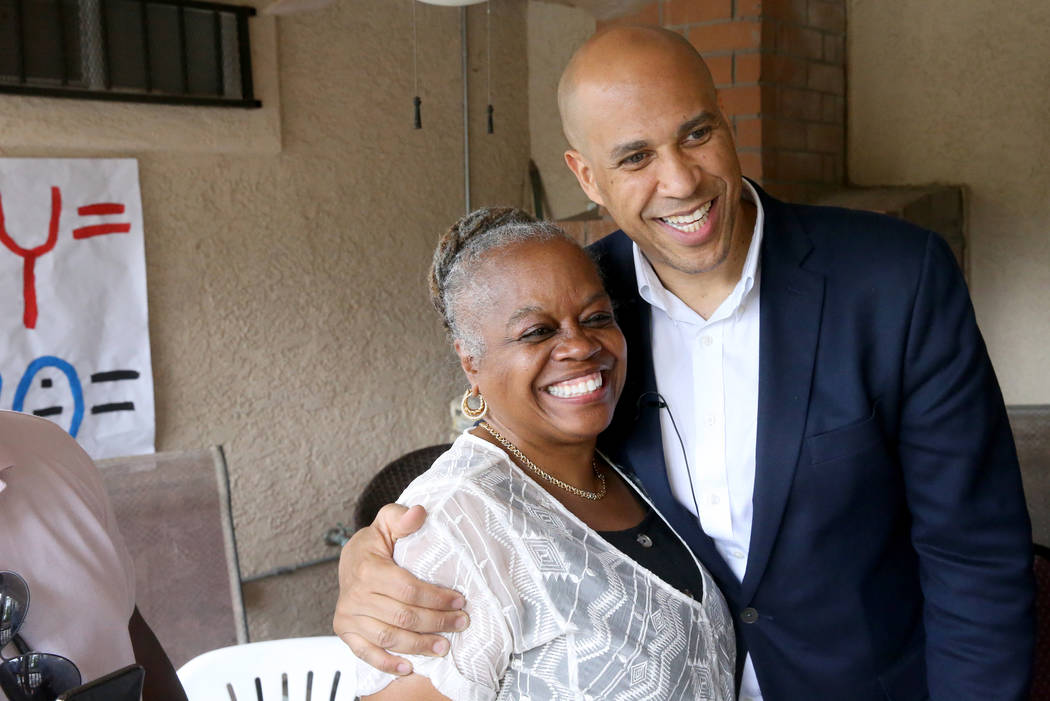 Presidential hopeful Sen. Cory Booker, D-N.J., poses with Pat Stevens of Las Vegas at a Miracle ...