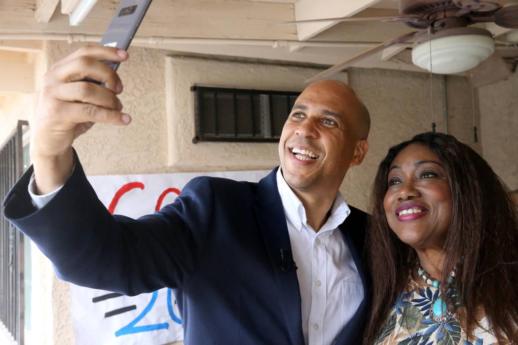 Presidential hopeful Sen. Cory Booker, D-N.J., takes a selfie Miriam Gibson of North Las Vegas ...