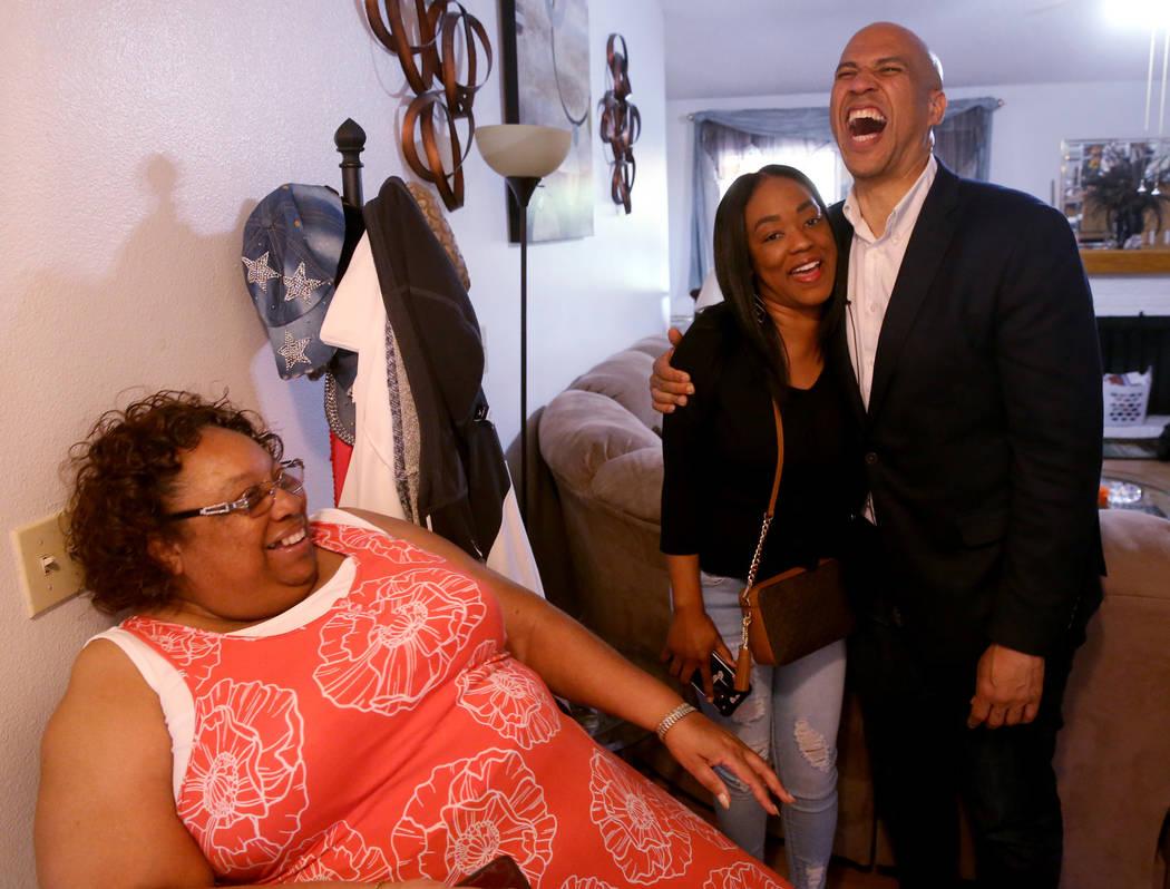Presidential hopeful Sen. Cory Booker, D-N.J., visits with Linda Green, left, and Nedra Shields ...