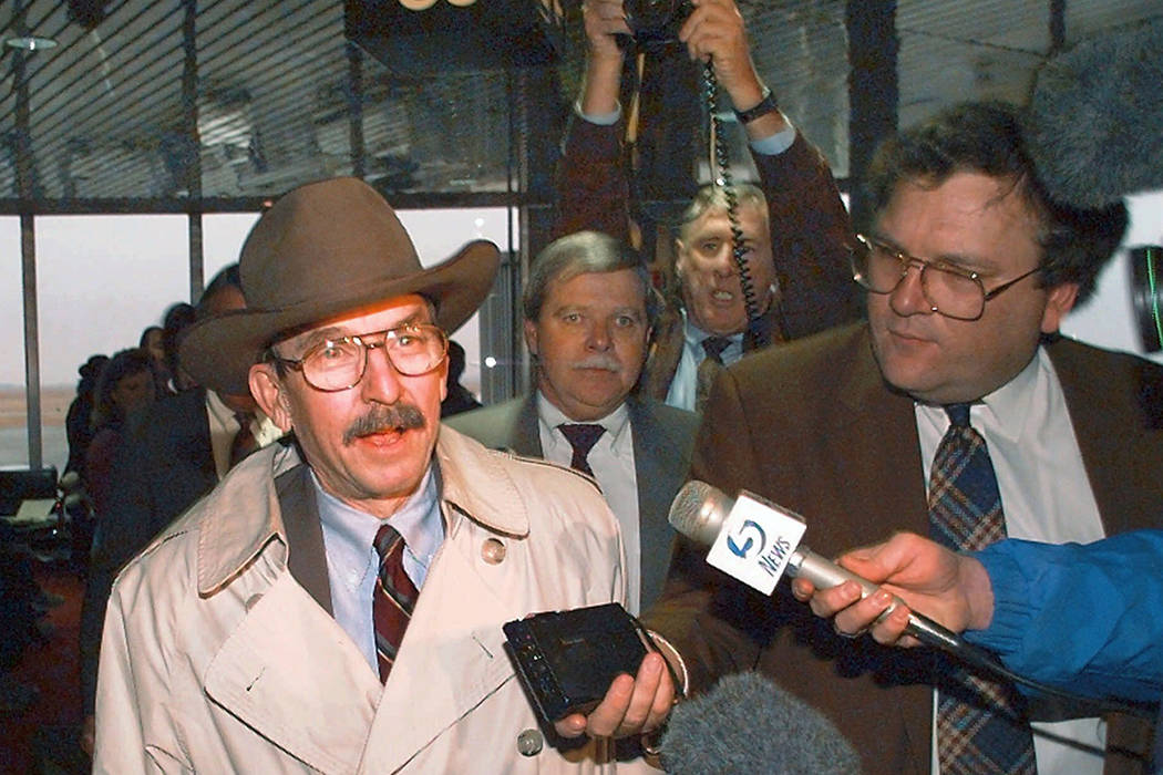 FILE - In this Dec. 12, 1995, file photo, U.S. Federal Judge Richard Matsch is swarmed by repor ...