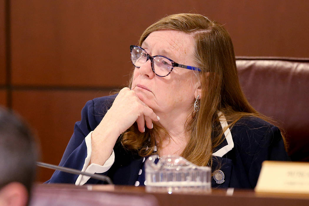 Assemblywoman Maggie Carlton, D-Las Vegas, listens to testimony during a Commerce and Labor Com ...