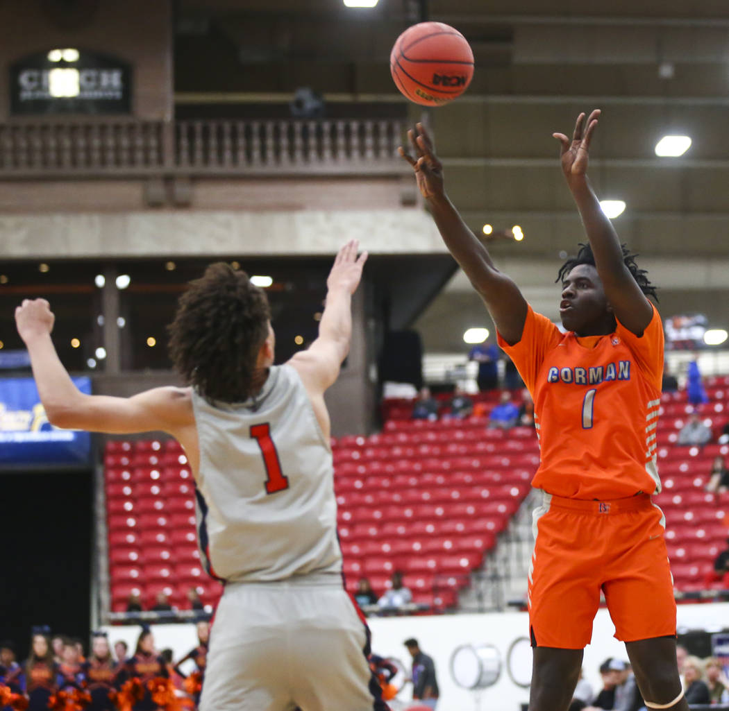 Bishop Gorman's Will McClendon (1) shoots over Findlay Prep's Blaise Beauchamp (1) during the f ...