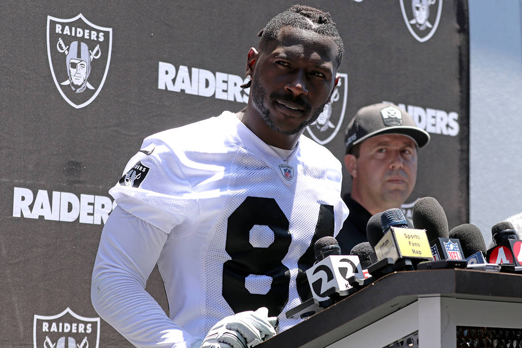 Oakland Raiders wide receiver Antonio Brown fields questions from reporters during a press conf ...